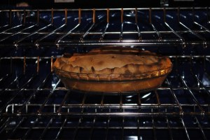 apple pie baking in oven